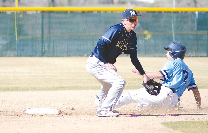 Ralston Valley senior Sam Lennarson (2) successfully steals second base as Mullen's Bryce Kamstra fields the throw on a short hop March 17 at Nate Jurney Field on the campus of Ralston Valley High School. Ralston Valley pounded out an 18-5 victory against Mullen.