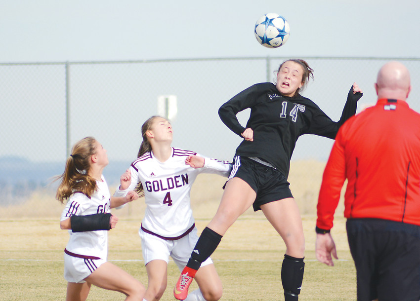 Arvada West junior Hailey Johns (14) goes up for a header during the Wildcats' 2-1 victory March 14 at the North Area Athletic Complex. A-West improved to 3-0 on the season with the victory.