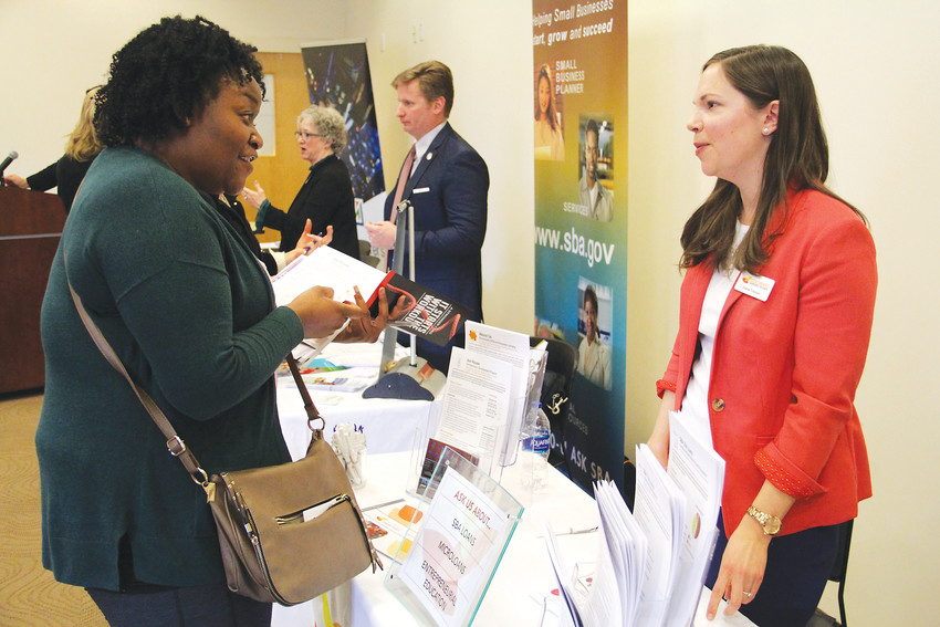 Cacharel Bynum, of Aurora, speaks to Diana Treinen, right, with Colorado Lending Source at the second annual Englewood Business Resource Expo March 15. Bynum wants to start a business that helps low-income families without present fathers work through emotional instabilities.