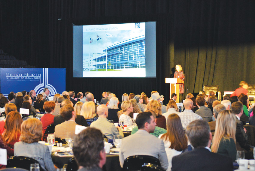 Denver International Airport President Kim Day speaks to the crowd March 15 to the Metro North Chamber of Commerce's State of the Region breakfast at the 1st Bank Center in Broomfield. Day outlined the airports planned expansion, which includes 39 new gates, relocated security and two additional concourse trains.