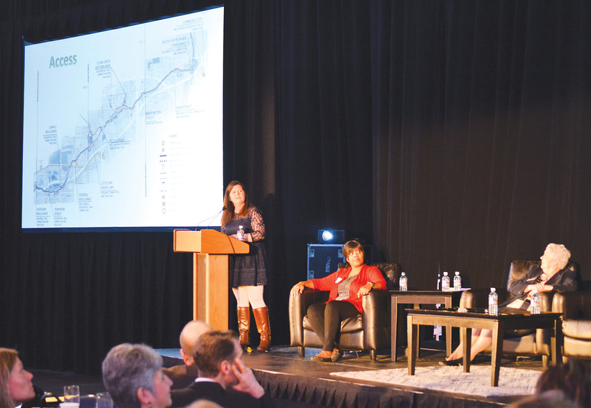 Shannon McDowell, manager of Adams County Parks and Open Space, talks about development plans along the Clear Creek Valley trail during the Metro North Chamber of Commerce's State of the Region breakfast March 15 at the 1stBank Center in Broomfield.