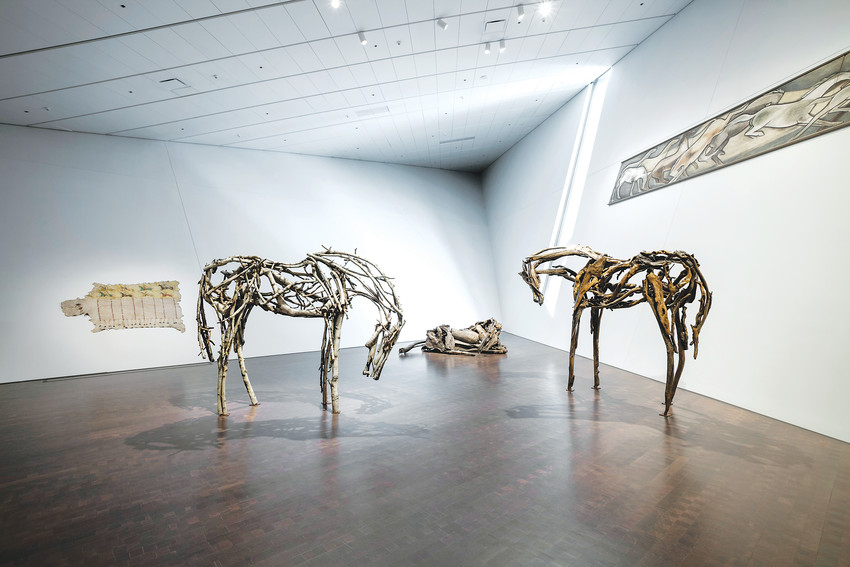 """Stampede"" Children are enjoying this group of three Deborah Butterfield horses, exhibited in ""Stampede."""