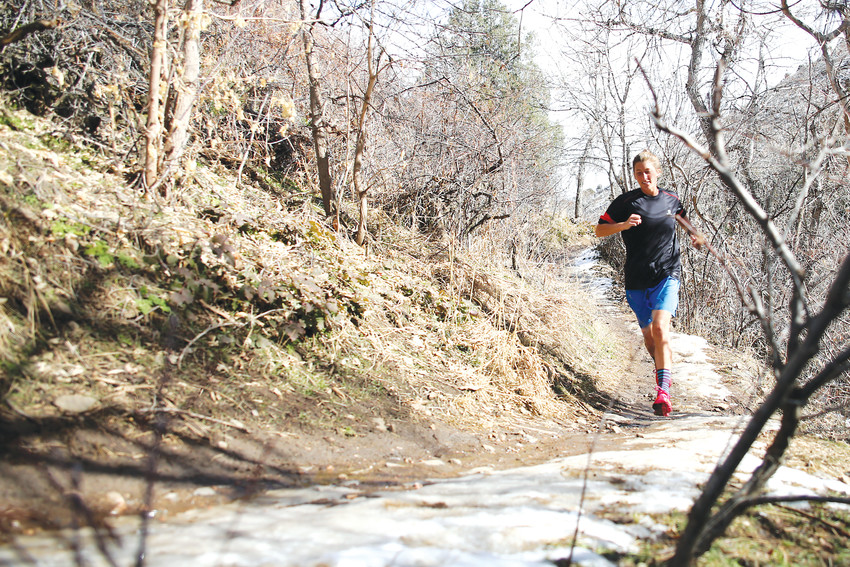 Ultra runner, Courtney Dauwalter, runs on Apex Trail in Golden on Feb. 14, 2018. Dauwalter finished first in the Moab 240, ten hours ahead of the next competitor.