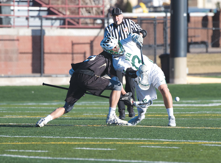 Mountain Vista's Landon Nolta (13) wins the face-off with Prairie View's Matt McGrane (9). The Golden Eagles won their season opener, 14-1, at Shea Stadium on Friday afternoon, March 15.