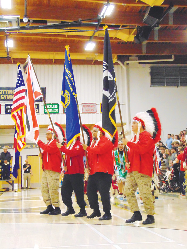 Members of the Arapaho Color Guard carry flags at the ceremony's outset.