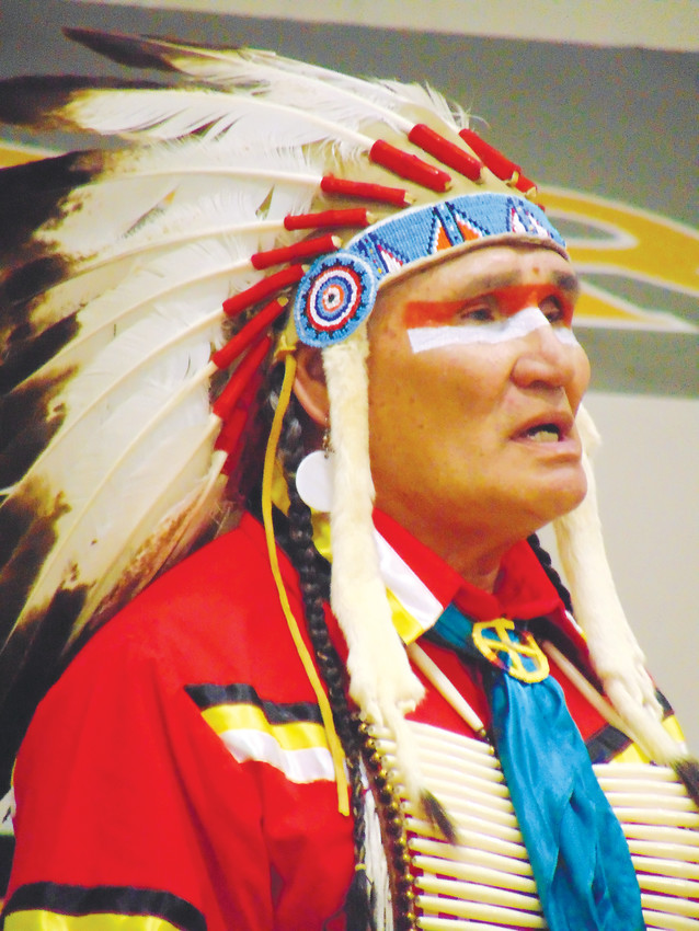 Arapaho tribal elder Darrell Lone Bear oversaw the ceremonial dancing at Arapahoe High School, which he said was to convey the warrior spirit.