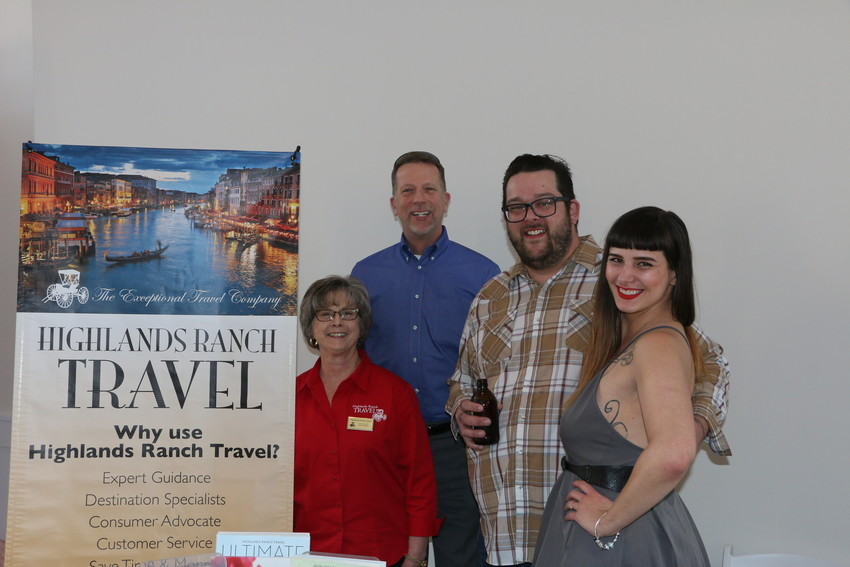 Linda Eyer and Dan Kraft of Highlands Ranch Travel award a couple a honeymoon cruise. Chad Howard and Mars Simich are the lucky winners.