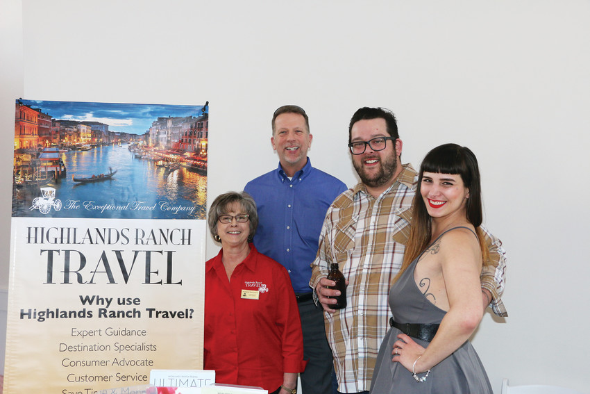 Linda Eyer and Dan Kraft of Highlands Ranch Travel congratulate Chad Howard and Mars Simich, the winners of the Cutest Engagement Story Contest. The couple won a seven-day honeymoon cruise from Highlands Ranch Travel.