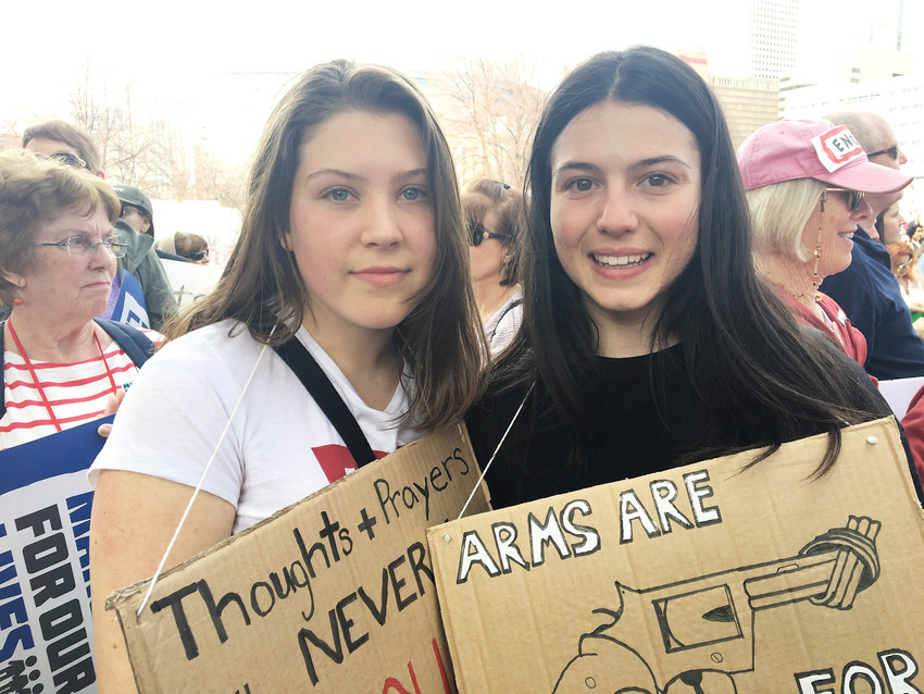 Ali Shultz, 16, left, and friend Michela Santucci, 17, an exchange student from Italy, are Boulder High School students who joined the thousands at Civic Center Park for Denver's March for Our Lives. They started crying when they talked about feeling safe at school.