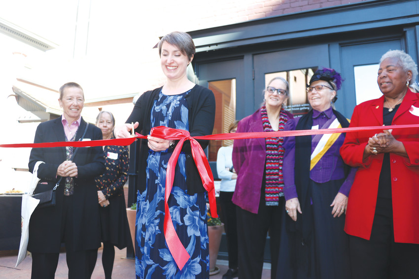 Jillian Allison, director of the new Center for Colorado Women's History at the Byers-Evans House Museum, cuts the ribbon for its opening March 21.