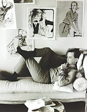 "Illustrator Jim Howard in 1965, amidst fashion drawings of the period. ""Drawn to Glamour, an exhibit of about 100 of his works is open at the Denver Art Museum."