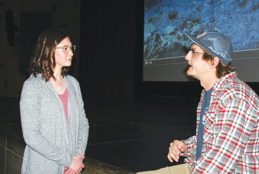 "Isabella Macarelli, a ninth-grader at Golden High School, talks with Zack Rago, a cast member of ""Chasing Coral,"" following his presentation at the school on March 21. Rago spoke to students about his experience as a career scientist as part of the students' climate change unit of the earth science class."