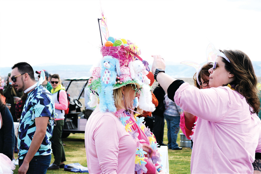 M.J. Jenel of Boulder helps Lisa Moeller of Centennial adjust her elaborate Easter Bonnet on Saturday March 24 at the Westminsters' Adult Egg Hunt at the Walnut Creek Golf Preserve. The event featured plenty of adult-themed events including an Easter Egg Hunt scramble for cash prizes and beer tokens, an egg drop and Easter Bonnet judging contest.