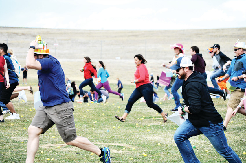 Participants race to claim cash filled Easter eggs at Westminster's Adult Egg Hunt at the Walnut Creek Golf Preserve on March 24.