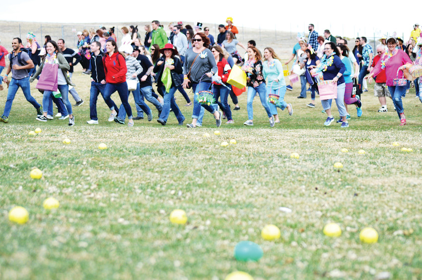 Pre-Easter revelers line up for the chance to claim cash-filled plastic Easter eggs at Westminsters' Adult Egg Hunt at the Walnut Creek Golf Preserve March 24.  The prize eggs were hidden among brightly colored golf balls littering the grass in front of the contestants.