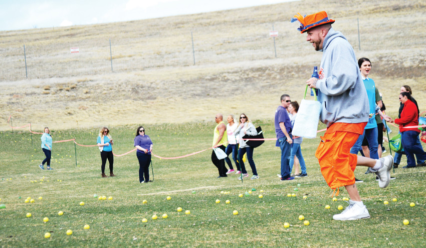A participant gets a jump on the egg hunt at Westminster's Adult Egg Hunt at the Walnut Creek Golf Preserve on March 24 while others line up.