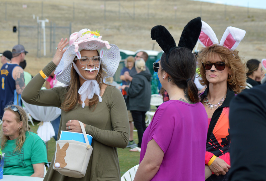 Cori Pitts of Parker, Sierra Bennett of Conifer and Laura Pitts of Westminster wait for their serious Easter bonnets to be judged at Westminster's Adult Egg Hunt at the Walnut Creek Golf Preserve on March 24.