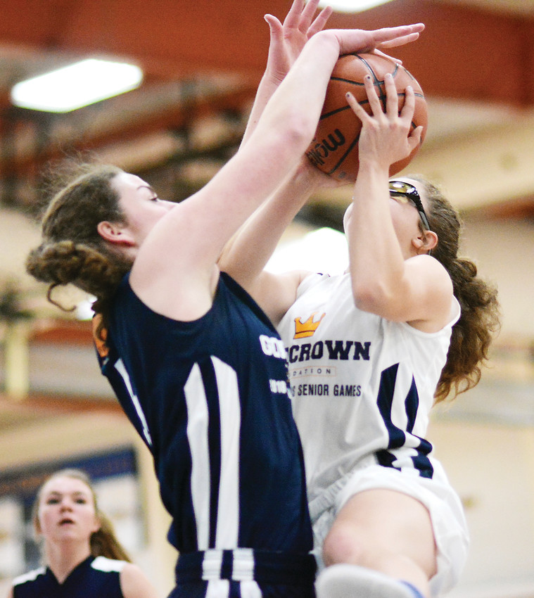 Golden senior Makena Prey, left, blocks the shot of Evergreen senior Kristina Schreiber during the first half March 19 at Gold Crown Field House. The White team defeated the Blue team, 78-75, in the girls' 2018 Jeffco High School Senior Basketball Game.
