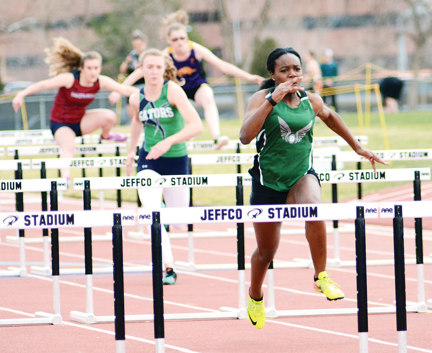 D'Evelyn junior Esther Diza-Mbelolo, far right, has a sizable lead in the girls 100-meter hurdles during the Jeffco Qualifier #2 on March 22 at Jeffco Stadium. Diza-Mbelolo ran a time of 15.28 seconds to win the event and help the Jaguars finish first in the team standings.