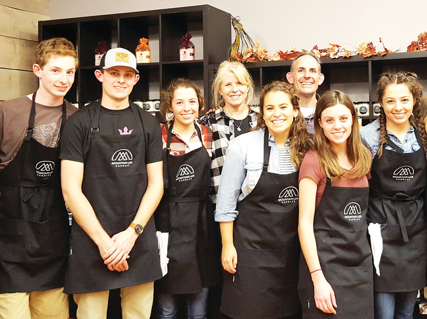 The Molnar family celebrates opening day of Mountain Lux Candles, 1111 Washington Ave., Suite 100 in Golden on Nov. 10. Pictured from left are Luke, Roman, Julia and Sharon Molnar; Lindsay Smith, who worked with the family doing consulting work for the shop; and Mark, Rachael and Abby Molnar.