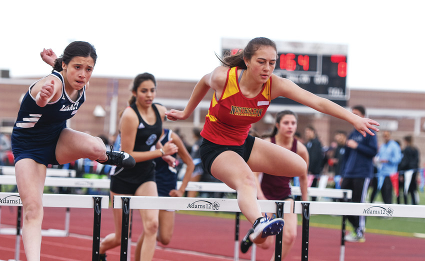Northglenn junior Melina Townsend, right, and Legacy freshman Alisa Minjarez, lead a group of hurdlers in a girls 100-meter intermediate event, at the March 21 Five Star Championships at District 12 North Stadium in Westminster.