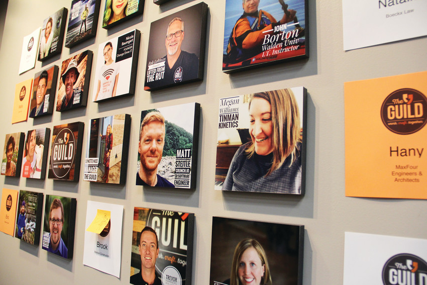 A wall displaying professionals who often work at The Guild, a co-working space at 3435 S. Inca St., Suite C, located near the Englewood Civic Center. The Greater Englewood Chamber of Commerce's 33rd annual business-awards gala was held at The Guild March 27.
