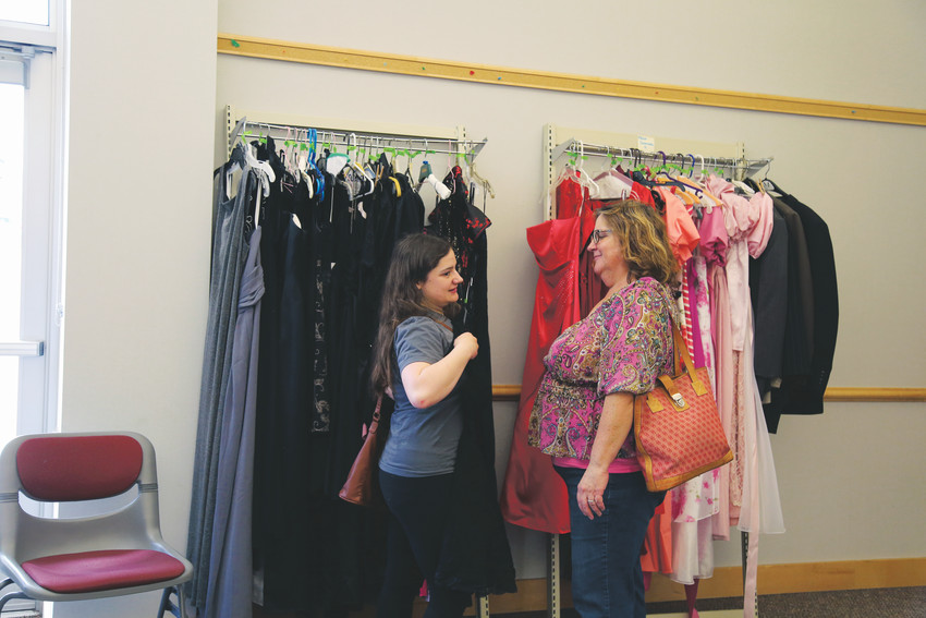Claire Frazier, 16, and her mother, Shari, look for prom dresses at the Arvada Library Prom Swap.