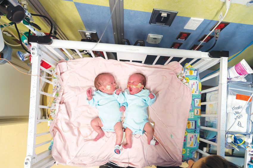 "Kenna, left, and Zoey Conley, born Jan. 4 — nine weeks premature after battling Twin-Twin Transfusion Syndrome — left Children's Hospital Colorado on March 2, just four days before their original due date. ""They're little miracle babies,"" their mother Kendal said."