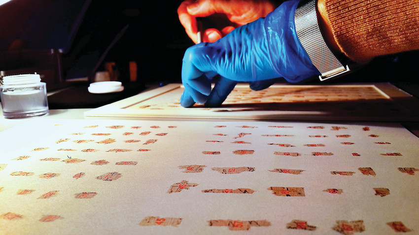 Conservators working at the IAA's Dead Sea Scrolls Conservation Laboratory. The scrolls were discovered in 1947, and are making their first visit to Denver.