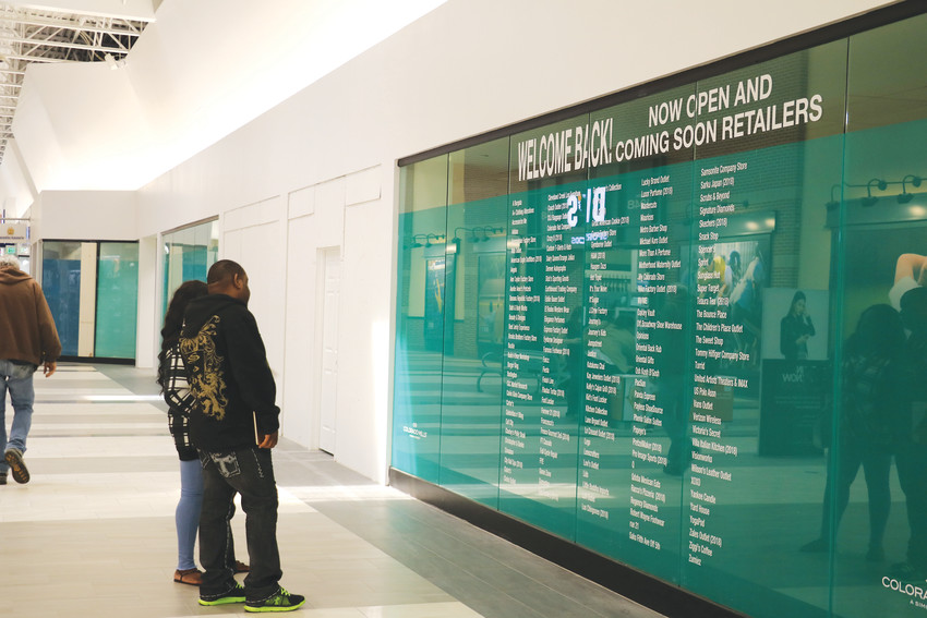 Bottom: Shoppers at the Colorado Mills Mall examine a list of opened and reopening businesses. About 155 businesses have opened already, and by the fall, Simon Property Group hopes to get the mall to close to 200 businesses.