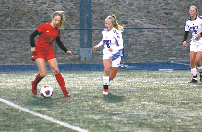 Castle View's Drew Baty, left, controls the ball in front of Douglas County's Avery Dietrich during the March 29 Continental League girls soccer match at Douglas County Stadium. Baty scored the game's first goal on a penalty kick and the Sabercats cruised to a 6-0 victory over the Huskies, which marked Castle View's fifth consecutive win over their crosstown rivals.
