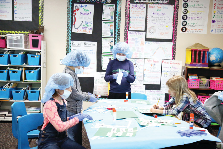 Students in a Faith Christian third-grade class conduct word surgery to create contractions.