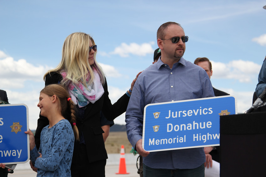 Velma Donahue places a hand on the shoulder of D.J. Jursevics. Donahue lost her husband, State Trooper Cody Donahue, in 2016 when he was hit and killed while working on Interstate 25. D.J. Jursevics lost his wife, State Trooper Jaimie Jursevics, in 2015 when she was also hit and killed while working along I-25.