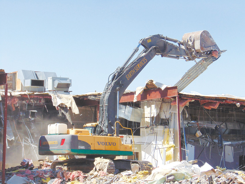 Excavators from Earth Services Abatement tear into the remaining structures of the long-vacant Columbine Square Shopping Center on April 3. The buildings sat empty since 2014, drawing transients, vandalism and other criminal activity.
