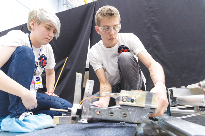 STEM student Zoe Maxwell and computer science student Javan Sandt work together to put the final touches on the group's project at NASA's Johnson Space Center in Houston.