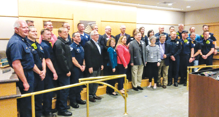 Westminster City Councilors, staff and members of the Westminster Professional Firefighters Local 2889 gather for a photograph just after councilors voted to approve and sign a new labor contract. The firefighter's union is the first labor contract negotiated and signed in the city.