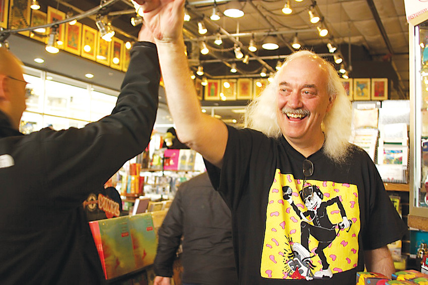 Paul Epstein, owner of Twist and Shout Records, high-fives the first customers into his store on Record Store Day. The annual event is an opportunity for vinyl fans to honor their favorite stores, and for store owners to thank their customers.