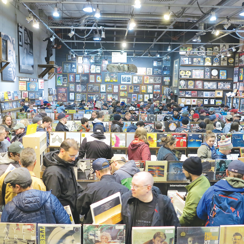 Shoppers wait in line at Twist and Shout Records with their Record Store Day purchases. The event is the biggest day of the year for most record stores, and employees are trained to make the process as smooth as possible.