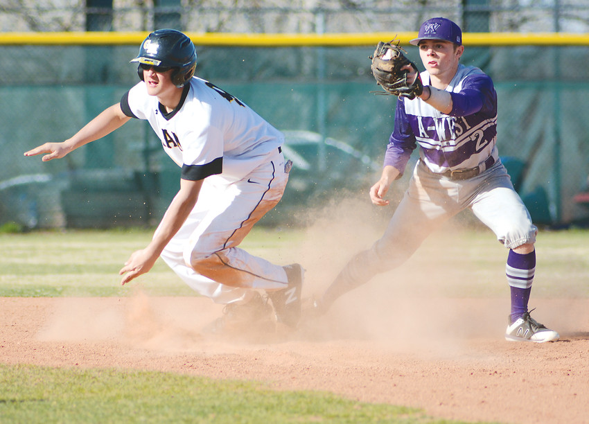 Green Mountain sophomore Danny Wiser, left, slides safely into second base as Arvada West senior Dylan Capritta doesn't get the call he was hoping for April 3 at Keli McGregor Field at All Star Park in Lakewood. A-West did come away with an 11-7 victory