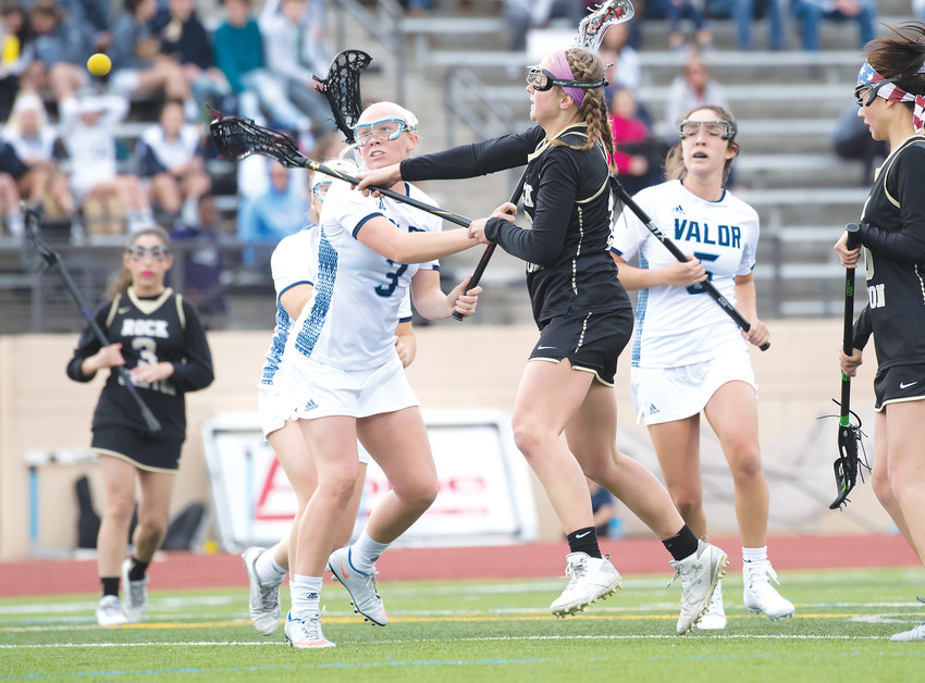Rock Canyon's Maren Clark gets off a shot on goal as Valor Christian's Tes Scott (3) tries to get in her way. The Eagles ended up defeating the co-op team from Rock Canyon and Highlands Ranch, winning 11-4 at Valor Stadium on April 5.