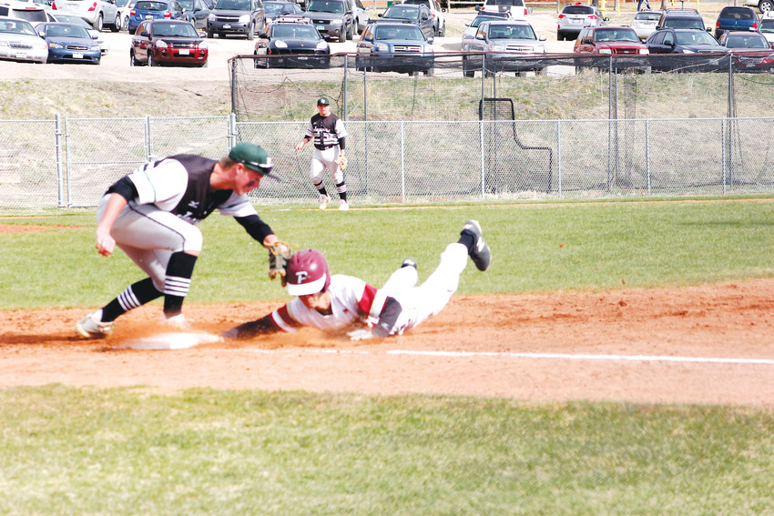 Ponderosa's Jared White dives safely back into first base on a pickoff attempt as D'Evelyn first baseman Evan Willis makes the tag. The Mustangs scored six runs in the fifth inning and went on to defeat the Jaguars, 10-7, in a non-league baseball game on April 5.