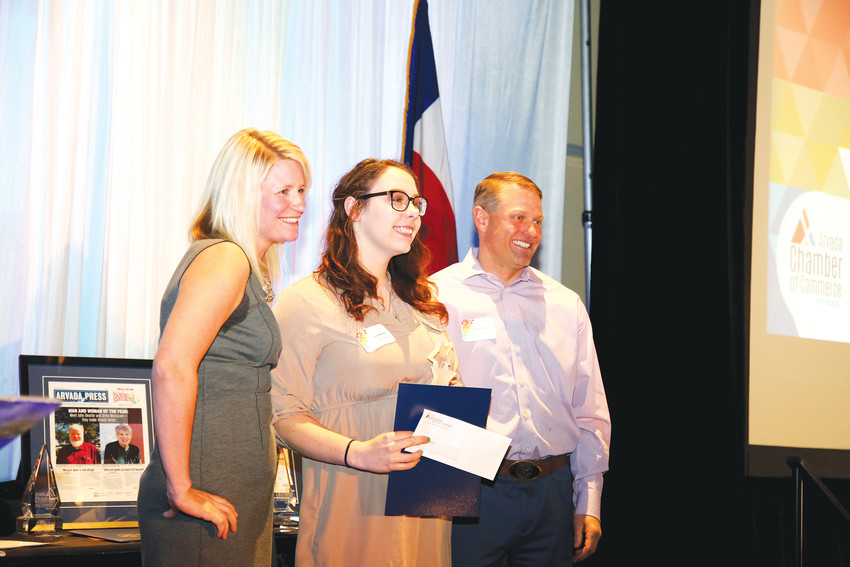 Arvada High School student Alyssa Martinez, center, accepts the Rising Star Award from Kami Welch and Michael McCarron with the Arvada Chamber of Commerce April 4.
