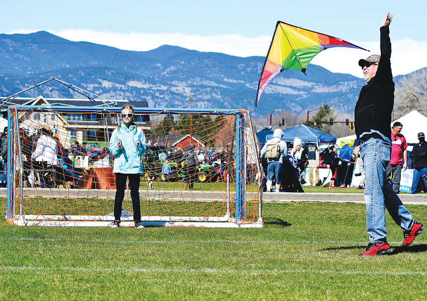 Gary Jones of Lakewood helps his granddaughter Ansley, 11, of Littleton launch her kite during the Arvada Kite Festival.