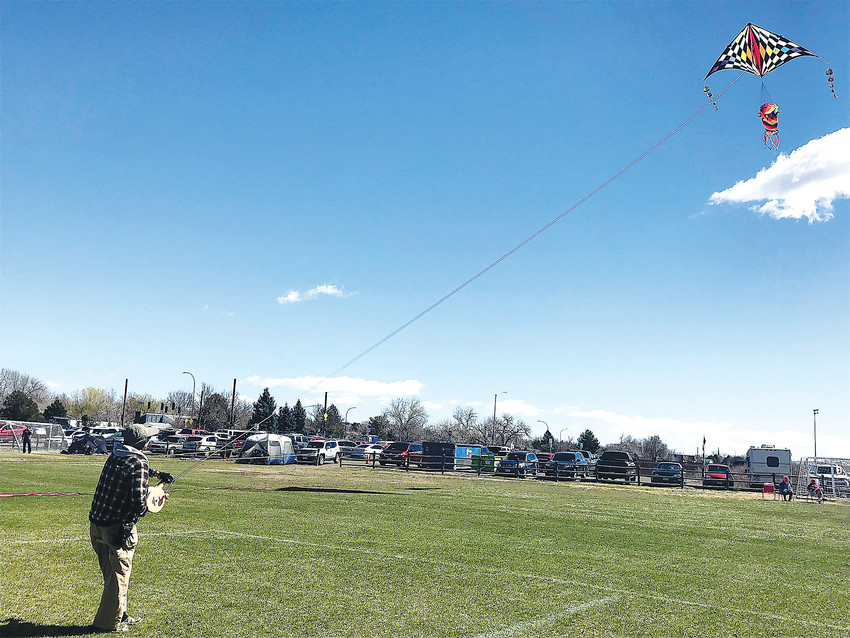"Art Bistline of Arvada controls his large kite during the annual Arvada Kite Festival on Sunday, April 8, at Stenger Soccer Complex. Bistline has been flying kites for about 30 years after seeing a large group of people flying kites along a beach in New Mexico. He thought the kite fliers would all be children, but he was surprised to find all ages. ""The oldest kid was 70,"" he said. Bistline's kite on Sunday measured 19 feet across and nine feet tall. He said any larger and he would have to follow FAA rules. The large kite catches a lot of wind, so he navigates it with a 500-pound line. ""This will pick me up,"" Bistline said. Festival goers on Sunday had plenty of wind, though it was gustier early on. ""It got wild this morning,"" Bistline said."