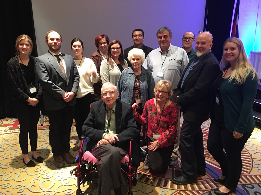 Former Littleton Independent editor Garrett Ray, front, poses for a photo with some of the staff of Colorado Community Media during the Colorado Press Association convention in Colorado Springs on April 14. Ray was inducted into the CPA Hall of Fame.