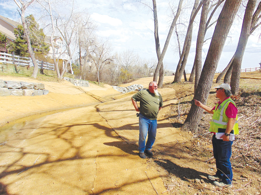 Arrowhead Landscaping owner Rick Kurth, left, plans out tree planting sites with Urban Drainage and Flood Control District senior construction manager Mike Sarmento along Jackass Gulch on April 12. Sarmento said the project will use all native and xeric plants.