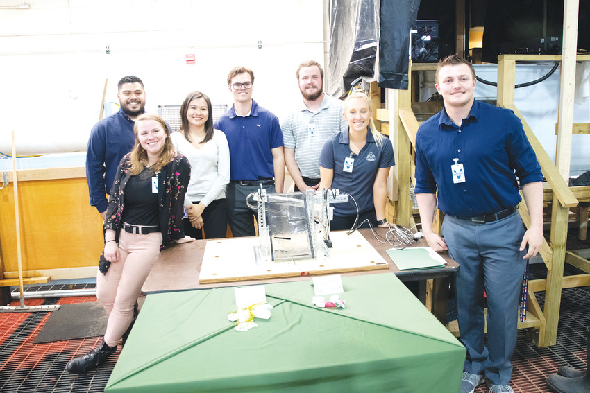 Colorado School of Mines' Team Go with the Float stands with their project during round two of the Clean River Design Challenge on April 10. The students won second place in the competition for their design.