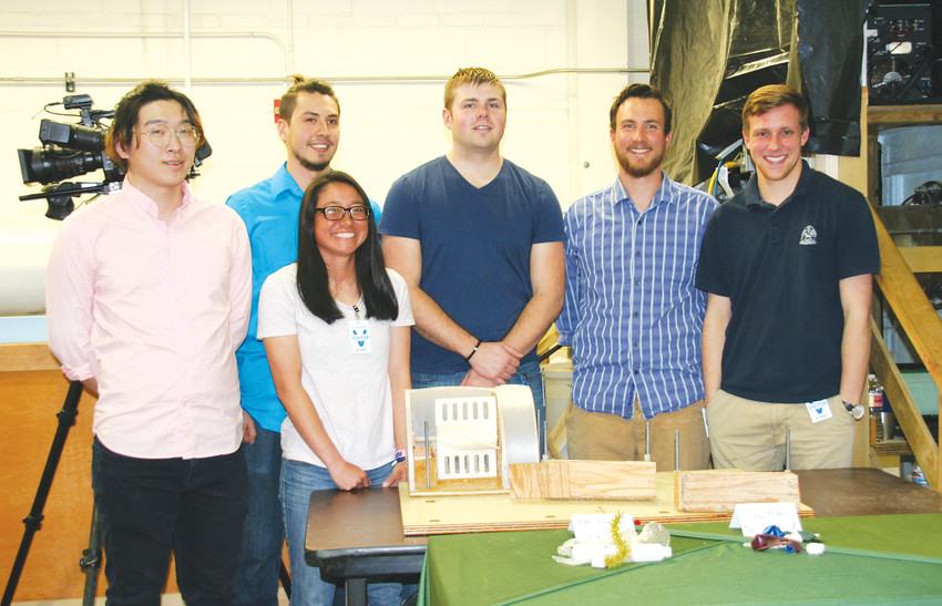 Colorado School of Mines' Team Dream Stream take a picture with their project during round two of the Clean River Design Challenge on April 10 at the Bureau of Reclamation Hydraulics Lab at the Denver Federal Center Bureau of Reclamation.
