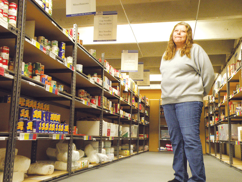 "Integrated Family Community Services food bank manager Barb Mesa in the organization's food pantry. Mesa said the food bank moved to a ""choice"" model three years ago, meaning visitors pick their own food rather than taking home a prepacked box."