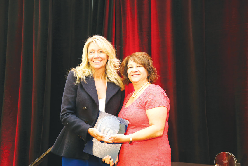 Heather Bulk, president and CEO of SAS Manufacturing based in Arvada, accepts a Business Recognition Award from Jefferson County Commissioner Libby Szabo at the 25th annual Jefferson County Economic Development Council Industry Appreciation Awards.